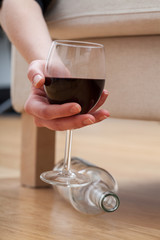 Woman holding a glass of wine