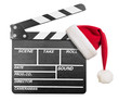 Clapper board with Santa's hat isolate - 57835405