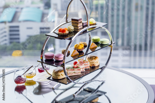 Papiers peints Macarons A afternoon tea set consisting of a collection of pastries