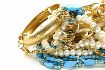 gold, turquoise jewelry and pearl,  on a white background
