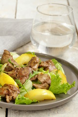 gourmet salad with a roasted chicken liver and apple