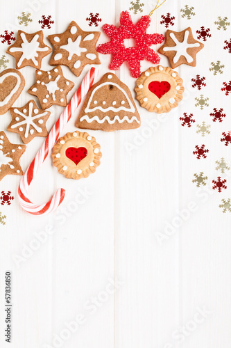 Christmas homemade gingerbread cookies and decoration over white