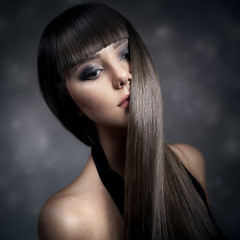 Portrait of a beautiful brunette woman with long straight hair