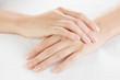 Leinwanddruck Bild - Beautiful woman hands are on a towel
