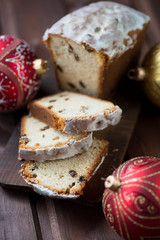 Vertical shot of sliced christmas cake, close-up