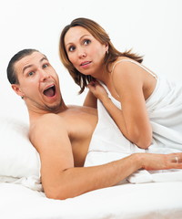 Middle-aged couple caught in bed
