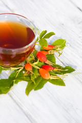 Rose Hip Tea on wooden background