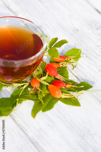 Rose Hip Tea on wooden background