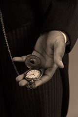 Close-up of hand of afro american man holding a vintage timepiec