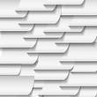 согнутые куски бумаги на сером фоне