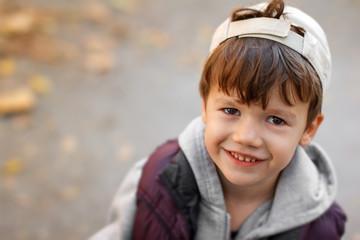 Little boy smile autumn portrait