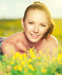 young happy woman on nature in the summer