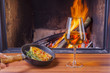 snacks and wine at cozy fireplace
