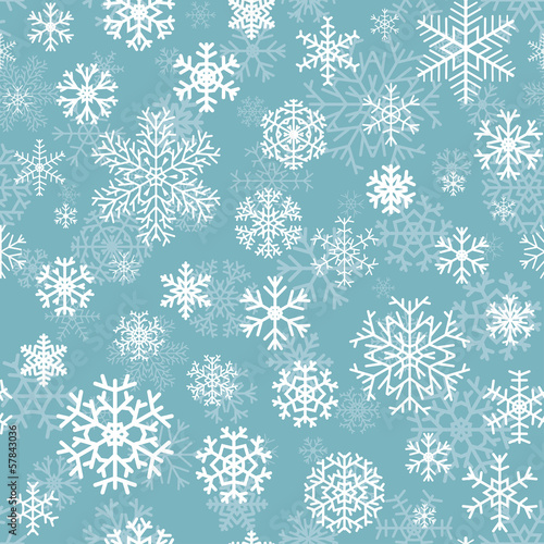Christmas seamless pattern from snowflakes on turquoise