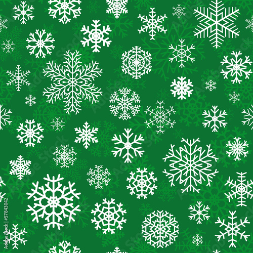 Christmas seamless pattern from snowflakes on green