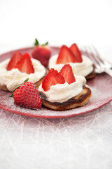 Pancakes with whipped cream and strawberry