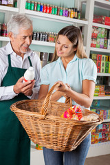 Salesman Assisting Customer Buying Groceries
