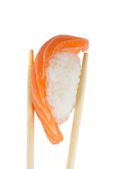 isolated salmon sushi nigiri in chopsticks on white background