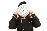 Chef woman behind clock