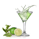 Green alcohol cocktail with splash, lime and mint isolated on wh