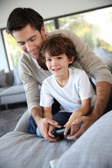Daddy with kid playing video game