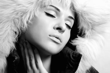 beautiful woman with fur. white fur hood.monochrome