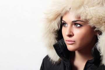 Beautiful woman with fur. hood. winter style.your text here