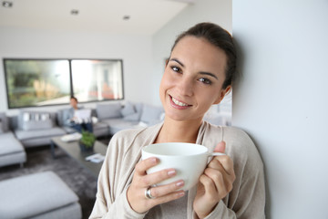 Beautiful woman at home drinking hot tea