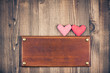 Love hearts, signboard frame on vintage wood background
