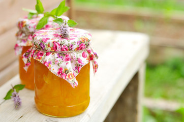 Two Jars of Pumpkin Jam on a Bench, copy space for your text