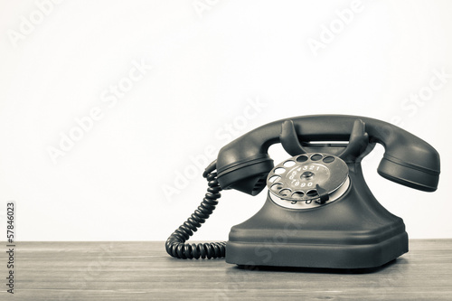 Retro telephone on table with empty place for vintage background