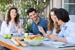 Leinwandbild Motiv Group Of Friends Having Dinner