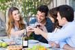 Leinwanddruck Bild - Group Of Friends Toasting Wine Glass
