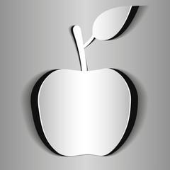 бумажное яблоко на сером фоне