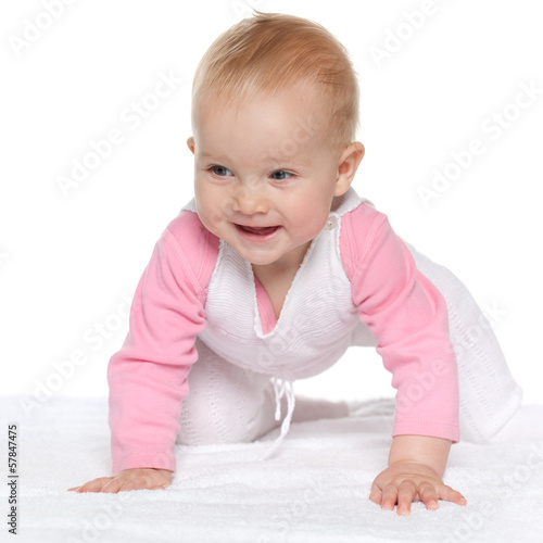 Smiling baby girl on the white towel