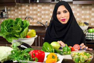 Arabian woman preparing salad in the kitchen