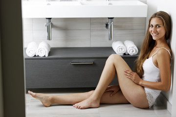 Woman sitting in her bathrrom