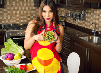 Beautiful woman serving homemade salad