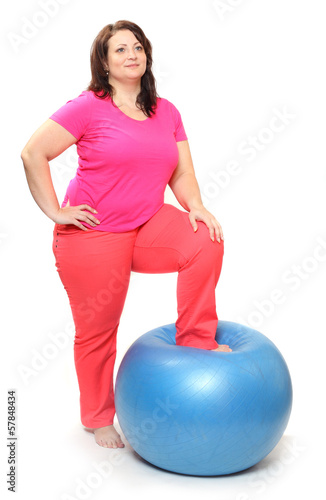 Obese woman with blue ball.