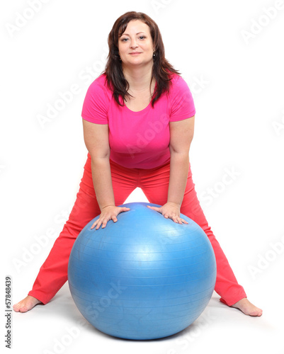 Overweight woman with blue ball. Weight loss concept.