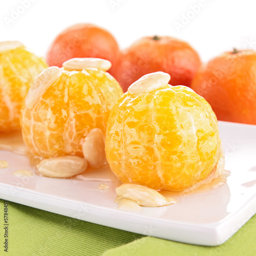 mandarin fruit with honey and nut