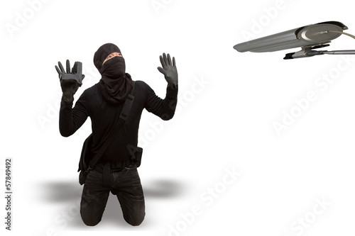 The thief surrendered criminal in a black mask  As cctv with cli