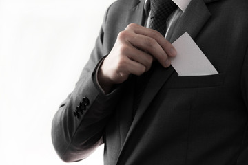 Businessman putting blank card in his pocket