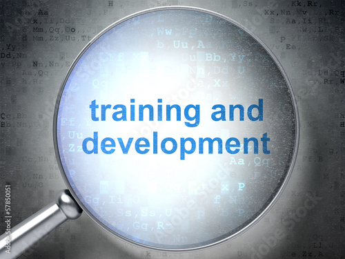 Education concept: Training and Development with optical glass