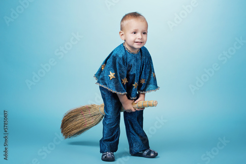 Little funny boy flying on broom