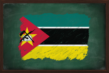 Mozambique flag painted with chalk on blackboard