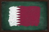 Qatar flag painted with chalk on blackboard