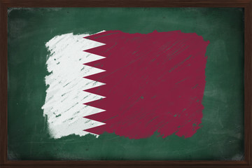 Qatar flag painted with chalk on blackboard