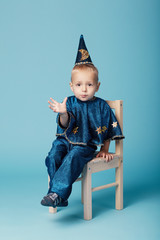 cute little magician portrait on blue background