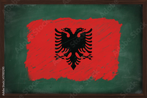 Albania flag painted with chalk on blackboard